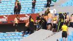 Escándalo en Uruguay: hinchas de Peñarol robaron en tienda dentro del Centenario - Noticias de raul ruidiaz